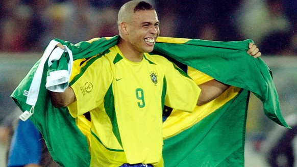 Brazil forward Ronaldo celebrates with the Brazilian flag after they defeated Germany 2-0 in the 2002 World Cup final Sunday, June 30, 2002 in Yokohama, Japan. (AP Photo/Amy Sancetta)