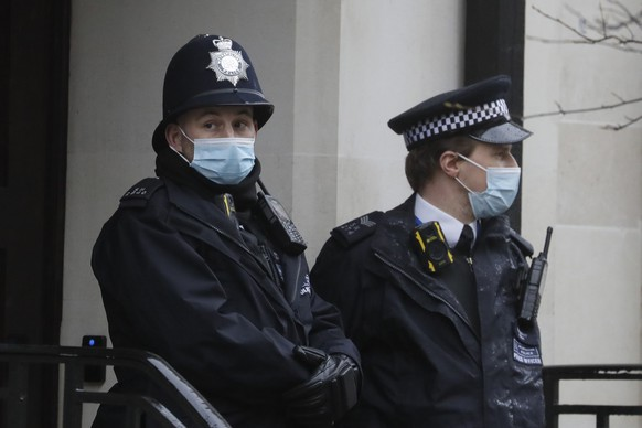 Police officers stand outside King Edward VII's hospital in London, Wednesday, Feb. 17, 2021. Buckingham Palace says 99-year-old Prince Philip has been admitted to a London hospital after feeling unwell. The palace says the husband of Queen Elizabeth II was admitted to the King Edward VII Hospital on the evening of Tuesday Feb. 16, 2021. (AP Photo/Kirsty Wigglesworth)
