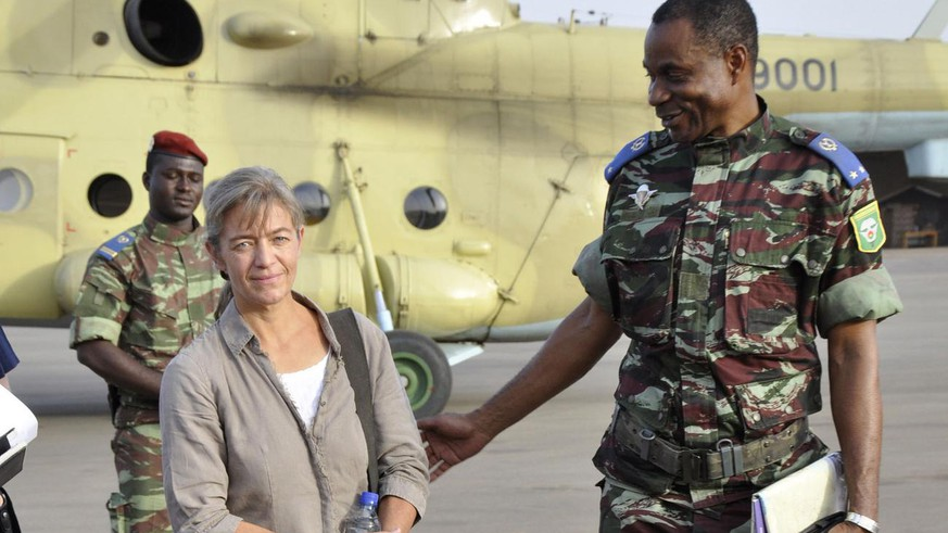 FILE - In this April 24, 2012, file photo, released Swiss hostage Beatrice Stoeckli, left, stands in Ouagadougou, Burkina Faso, following arrival by helicopter from Timbuktu, Mali, after being handed over by militant Islamic group Ansar Dine. Switzerland