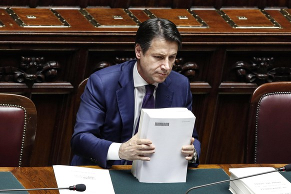 Italian Premier Giuseppe Conte attends a debate prior to a final vote to formally approve the 2019 budget law, at the Italian lower chamber of the Italian Parliament, in Rome, Sunday, Dec. 30, 2018. The Italian government has already won Saturday night a confidence vote on the 2019 national budget that includes funding to realize campaign promises made by leaders of Italy's populist government. (Giuseppe Lami/ANSA via AP)