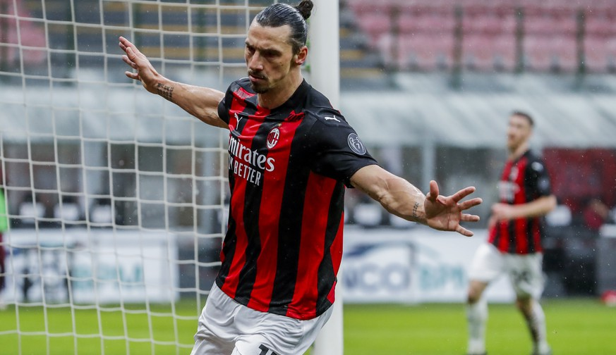 AC Milan's Zlatan Ibrahimovic celebrates after scoring the opening goal during the Serie A soccer match between AC Milan and Crotone at the San Siro stadium in Milan, Italy, Sunday, Feb. 7, 2021. (AP Photo/Antonio Calanni)