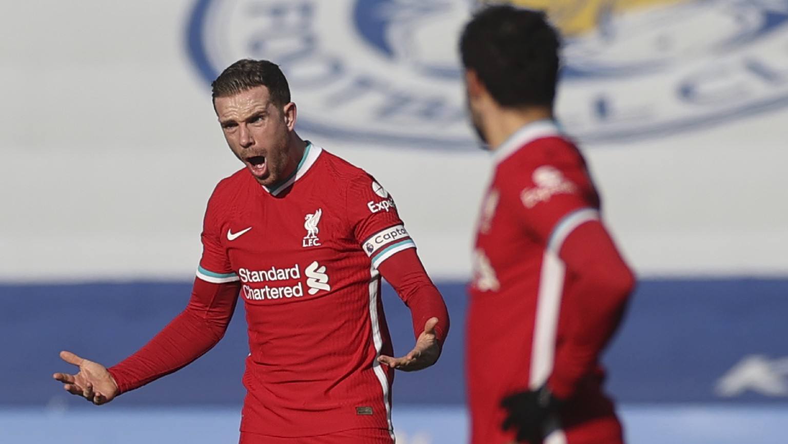 Liverpool's Jordan Henderson, left, shouts out during the English Premier League soccer match between Leicester City and Liverpool at the King Power Stadium in Leicester, England, Saturday, Feb. 13, 2021. (Carl Recine/Pool Photo via AP)