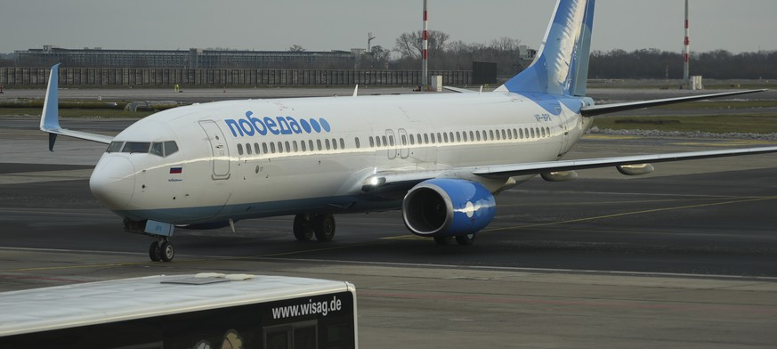 Boeing 737-800 of Pobeda Russian air company on which Alexei Navalny is expected to fly to Moscow, as it arrives to the Airport Berlin Brandenburg (BER) in Schoenefeld, near Berlin, Germany, Sunday, Jan. 17, 2021. Leading Kremlin critic Alexei Navalny plans to fly home to Russia on Sunday after recovering in Germany from his poisoning in August with a nerve agent. (AP Photo/Mstyslav Chernov)