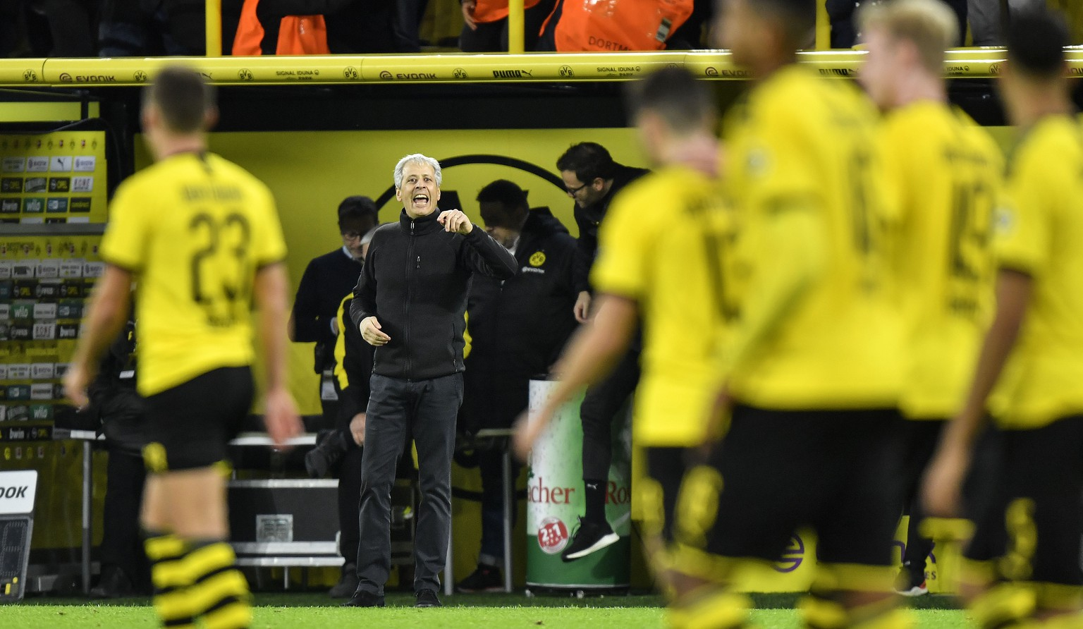 Dortmund's head coach Lucien Favre reacts to his team during the German Bundesliga soccer match between Borussia Dortmund and VfL Wolfsburg in Dortmund, Germany, Saturday Nov. 2, 2019. (AP Photo/Martin Meissner)