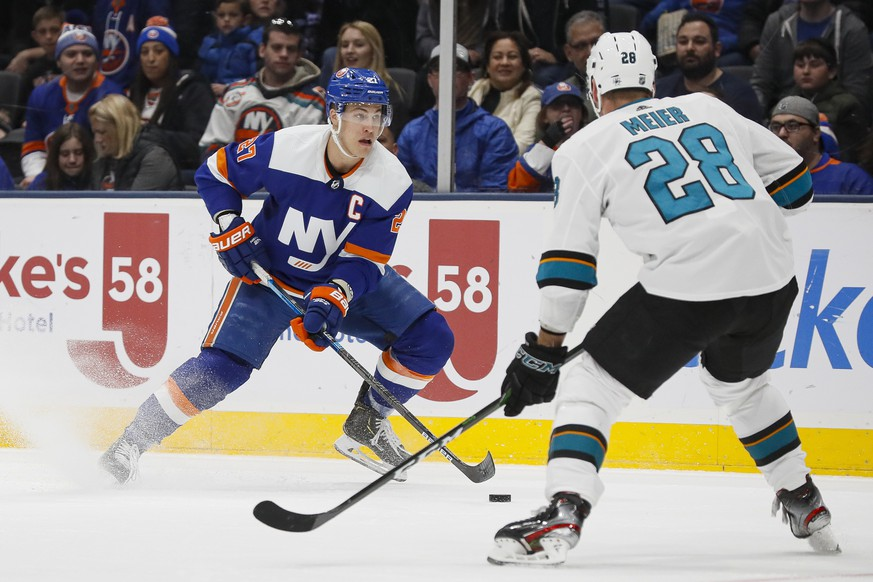New York Islanders left wing Anders Lee (27) looks to pass against San Jose Sharks right wing Timo Meier (28) during the second period of an NHL hockey game, Sunday, Feb. 23, 2020, in Uniondale, NY. (AP Photo/John Minchillo) Anders Lee,Timo Meier