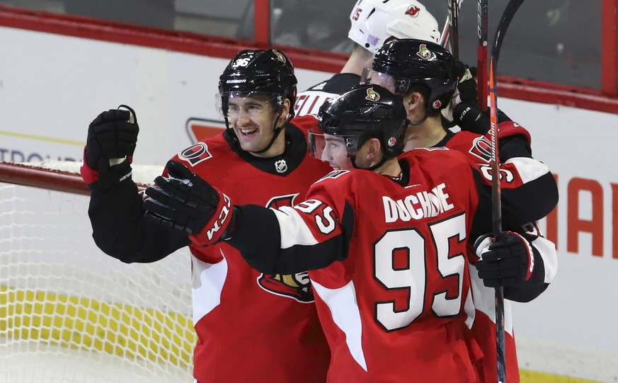 Ottawa Senators' Colin White (36) celebrates his goal against the New Jersey Devils with Matt Duchene (95) and Mark Stone (61) during the second period of an NHL hockey game, Tuesday, Nov. 6, 2018 in Ottawa, Ontario. (Fred Chartrand/The Canadian Press via AP)