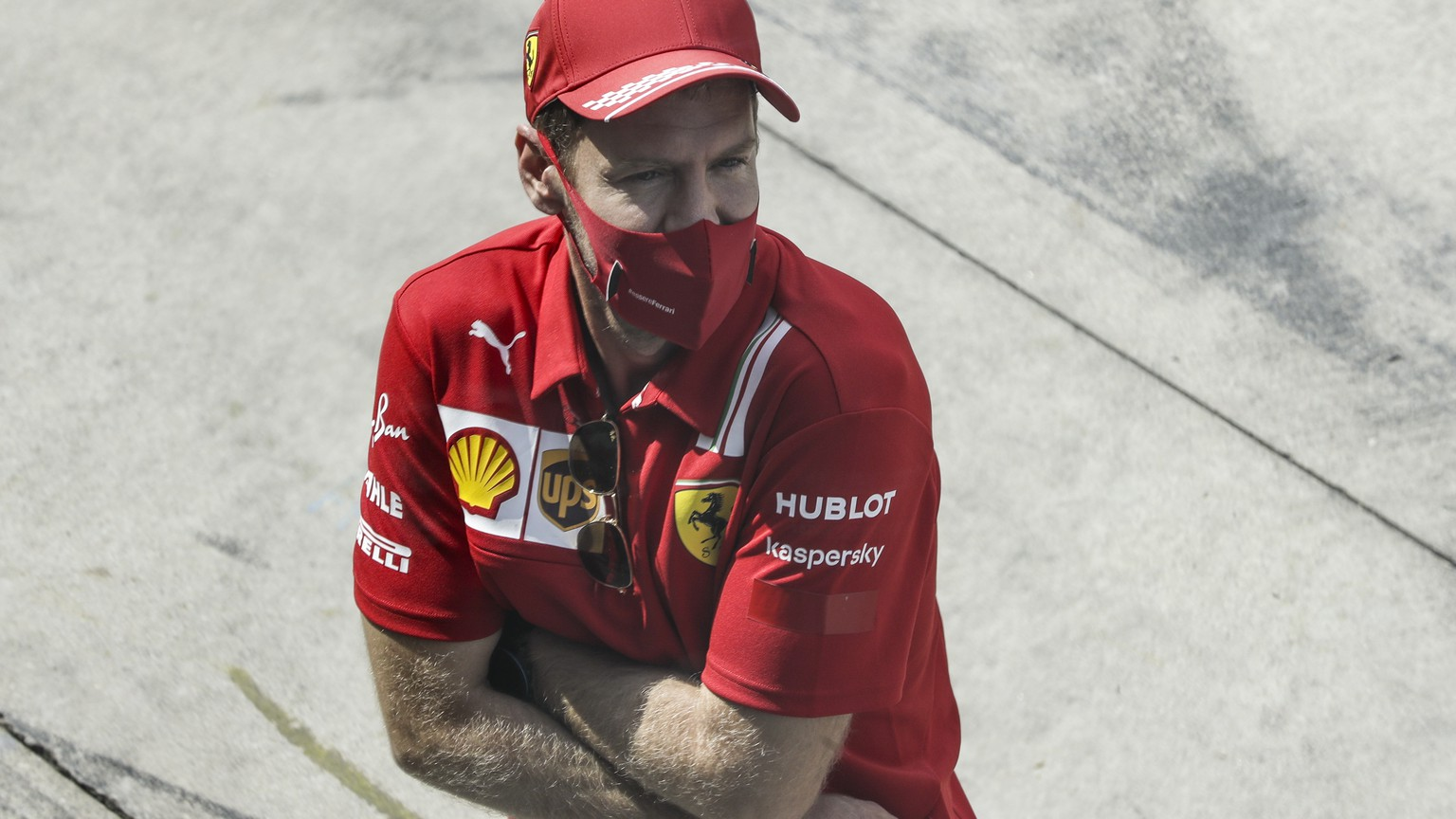 epa08650372 German Formula One driver Sebastian Vettel of Scuderia Ferrari walks at pit lane prior to the 2020 Formula One Grand Prix of Italy at the Monza race track, Monza, Italy 06 September 2020.  EPA/Luca Bruno / Pool