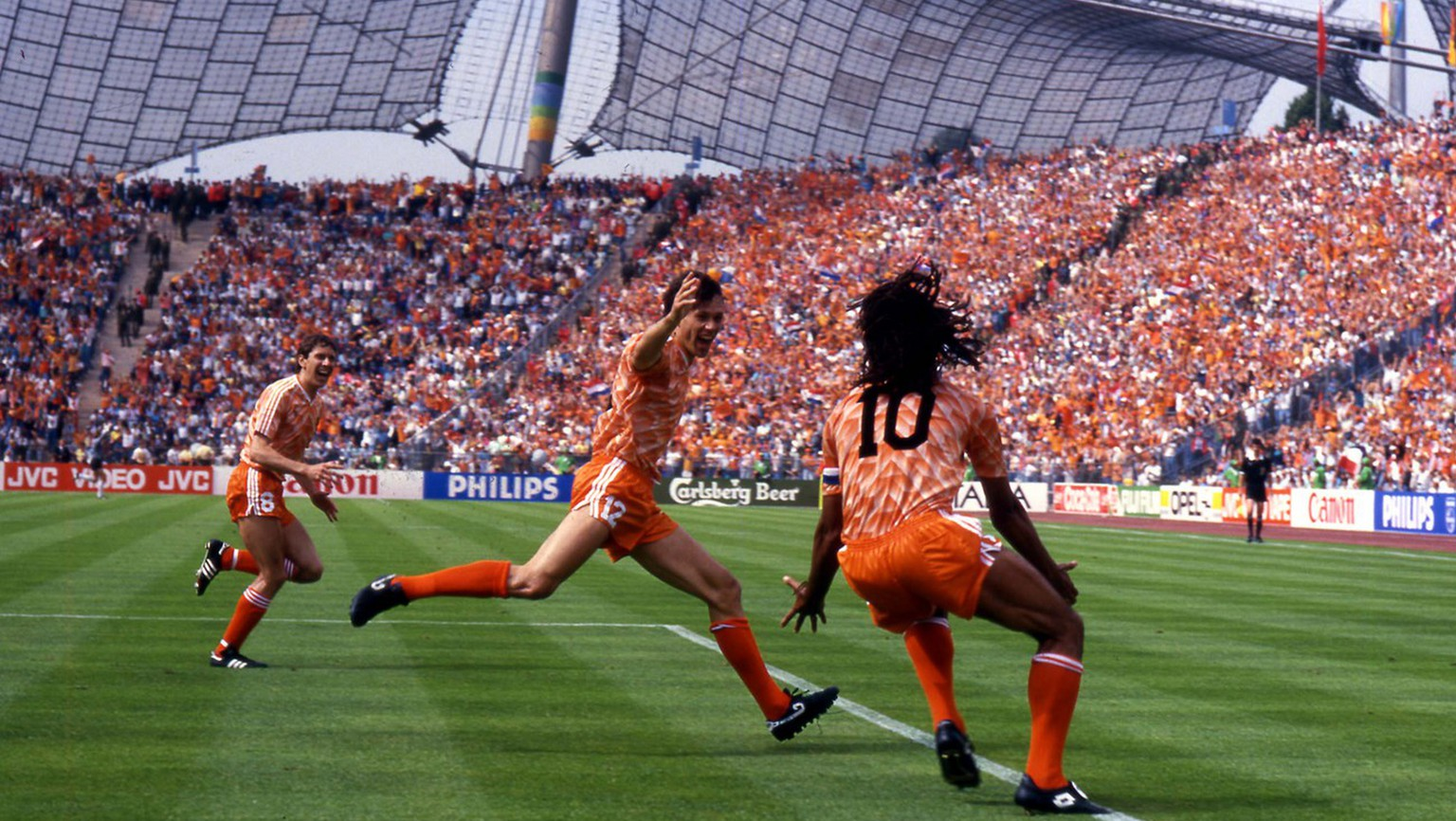 Marco Van Basten, at center, of the Netherlands soccer team celebrate with teammate Ruud Gullit, right, after scoring the winning goal during the final game of the European soccer Championships, on June 25, 1988 in Munich, West Germany. The Netherlands defeated Soviet Union 2-0 to win the Championship. (Ap Photo/Carlo Fumagalli)