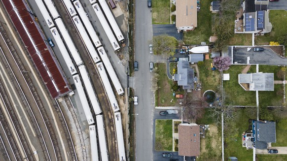 epa09133715 A picture taken with a drone shows a Long Island Railroad commuter train yard and a suburban neighborhood in West Islip, New York, USA, 13 April 2021. The Biden administration recently unveiling a massive $2.3 trillion dollar /?1.9 trillion euro plan aimed at improving and upgrading the country?s infrastructure, including a proposed $620 billion for transportation spending.  EPA/JUSTIN LANE